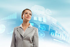 Businesswoman smiling. Image of attractive businesswoman against hightech background stock photography