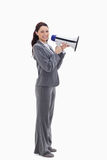 A businesswoman smiling with a megaphone Royalty Free Stock Photos