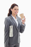 Businesswoman smiling with a newspaper Stock Photos