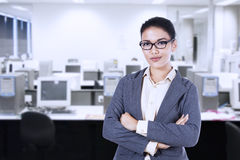 Businesswoman smiling in an office Stock Image