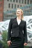 Businesswoman smiling outdoors in the city Royalty Free Stock Photography