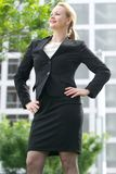 Businesswoman smiling outdoors in the city Stock Photo