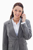 Businesswoman smiling over the phone. Against white background Royalty Free Stock Images