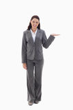 Businesswoman smiling and presenting a product Royalty Free Stock Image