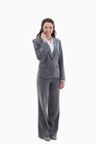 Businesswoman smiling and speaking with a headset Royalty Free Stock Photo