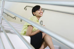 Businesswoman Smiling On Stairs Royalty Free Stock Photo