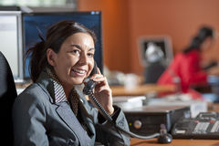 Businesswoman Smiling and Talking on a Phone Stock Images
