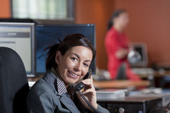 Businesswoman Smiling and Talking on a Phone Royalty Free Stock Image