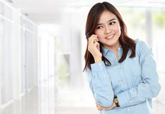 Businesswoman smiling and talking by phone Royalty Free Stock Image