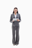 Businesswoman smiling with a touch pad. Against white background Royalty Free Stock Photo