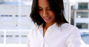 Businesswoman smiling and using a smart watch stock video footage