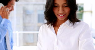 Businesswoman smiling and using a smart watch stock video