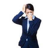 Businesswoman sneeze and headache Stock Images