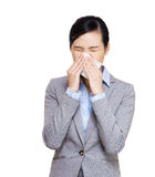 Businesswoman sneeze Royalty Free Stock Photos