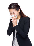 Businesswoman sneeze. Isolated on white Stock Photo