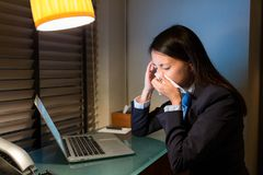 Businesswoman sneeze at office Stock Photos