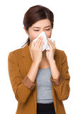 Businesswoman sneeze wnd feeling cold Stock Photography
