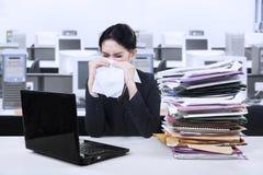 Businesswoman sneezing Royalty Free Stock Photos