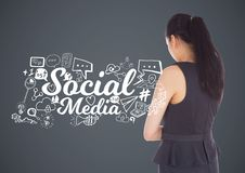 Businesswoman with social media graphics drawings Stock Photo