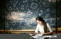 Businesswoman with social media symbols Stock Photos