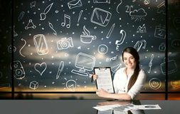Businesswoman with social media symbols Stock Photography