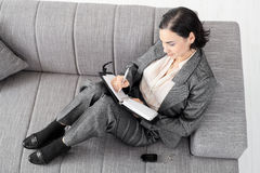 Businesswoman on sofa Royalty Free Stock Images