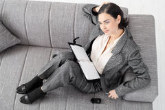 Businesswoman on sofa Royalty Free Stock Photos