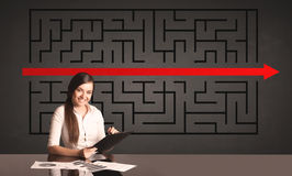 Businesswoman with a solved puzzle in background Stock Image