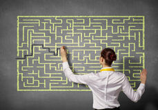 Businesswoman solving maze problem Royalty Free Stock Photography