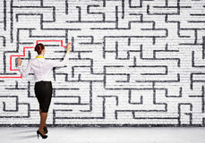 Businesswoman solving maze problem Royalty Free Stock Photos