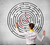 Businesswoman solving maze problem Stock Photos