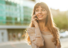 Businesswoman. Sophisticated businesswoman in dress talking on the phone Royalty Free Stock Image
