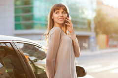Businesswoman. Sophisticated businesswoman in dress talking on the phone Stock Photo
