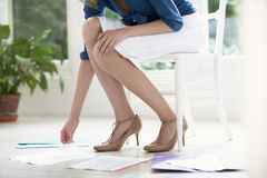 Businesswoman Sorting Papers In Living Room Stock Photos