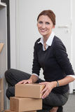 Businesswoman sorts parcels Stock Photography