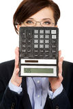 Businesswoman with SOS writing on calculator. Royalty Free Stock Photography