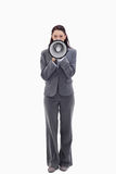 Businesswoman speaking in a megaphone Stock Photos