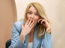 Businesswoman speaking by mobile phone Royalty Free Stock Photo