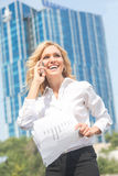 Businesswoman speaking over mobile phone Royalty Free Stock Photo