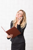 Businesswoman speaking over mobile phone in the office Royalty Free Stock Photo