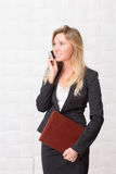 Businesswoman speaking over mobile phone in the office Royalty Free Stock Images