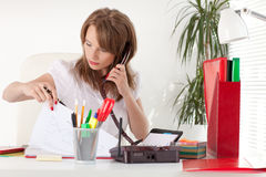 Businesswoman speaks  by phone at the office. Stock Images
