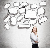 Businesswoman with speech bubbles Royalty Free Stock Photography
