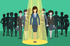 Businesswoman in spotlight. Picking the right Stock Photography