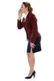Businesswoman spreading gossips Stock Photo