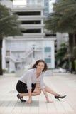 Businesswoman squatting Stock Photography