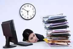Businesswoman with stack of document Royalty Free Stock Photo
