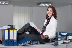 Businesswoman with a stack of files Royalty Free Stock Image