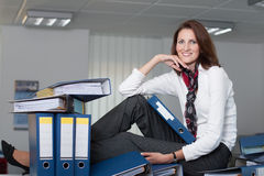 Businesswoman with a stack of files Stock Photo