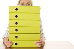 Businesswoman With Stack Of Folders Royalty Free Stock Photography